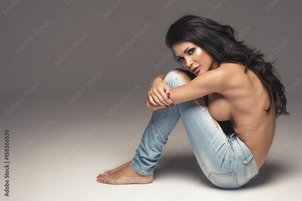 Fototapety, obrazy: Sexy attractive brunette woman posing only in jeans in studio