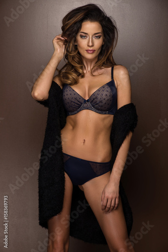 05f5eb233 Portrait of young brunette woman in dark lingerie - Buy this stock ...