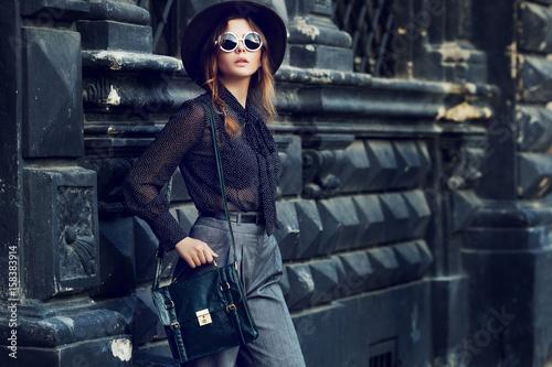 Fotografie, Obraz  Outdoor portrait of young beautiful woman, businesswoman posing in street, european city