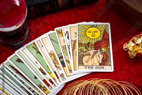 Foto Fortune teller and whitcraft concept with tarot cards spread on red velvet surro