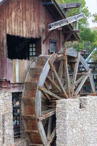 The old hydraulic structure. Vintage wooden water mill. The mill wheel without movement.