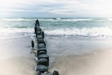 FototapetaWooden breakwater in the stormy sea. Seascape, Baltic sea near Klaipeda, Lithuania. Vintage effect.