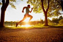Man Running Fast In Park Durin...