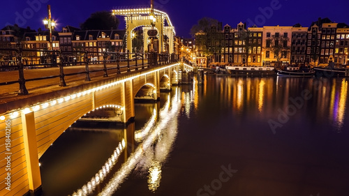 Photo Bridges and embankments of Amsterdam at twilight time