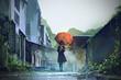 Leinwanddruck Bild - mysterious woman holds orange umbrella standing on street in abandoned city with digital art style, illustration painting