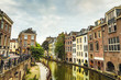 canvas print picture - The most famous canals and embankments of Utrecht city during sunset. General view of the cityscape and traditional Netherlands architecture.