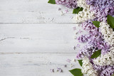 Fototapeta Kwiaty - A wooden background with flowering lilac branches