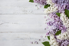 A Wooden Background With Flowe...