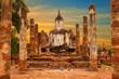 Huge Buddha statue at sunset. Wat Mahathat (temple). Sukhothai Historical Park, Thailand. Unesco World Heritage Site.