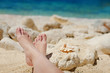 Bare feet in the sea on the shore of the Sea
