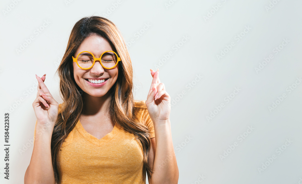 Fototapety, obrazy: Young woman wishing for good luck
