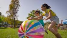 Two Little Girls Running After...