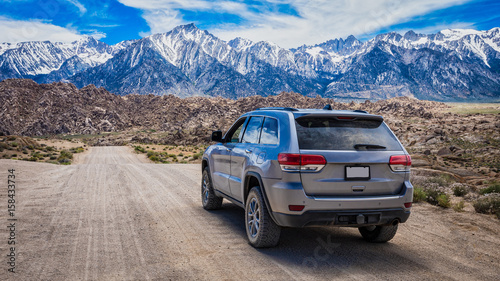 Fotografie, Obraz  SUV on Mountain Dirt Road