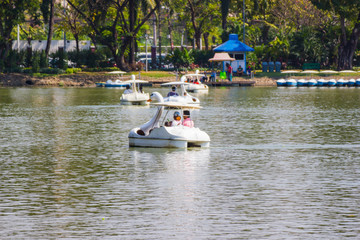 Fototapeta na wymiar Blurred - Bangkok Thailand : People relax on a boat in a city park  in Lumpini Park