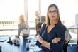 Leinwanddruck Bild - Serious business woman in front of team