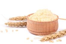 Wheat Porridge In Wooden Bowl Isolated On White Background