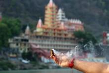 Hindu Man Doing Puja For Ganga...