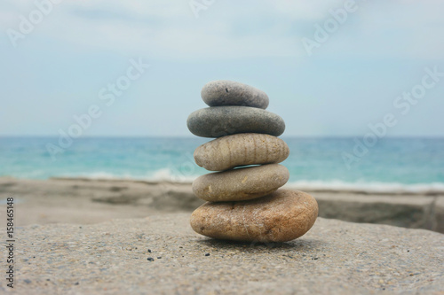 Photo Stands Stones in Sand pyramid of stones on the beach