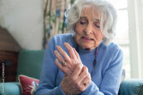 Senior Woman At Home Suffering With Arthritis Wallpaper Mural