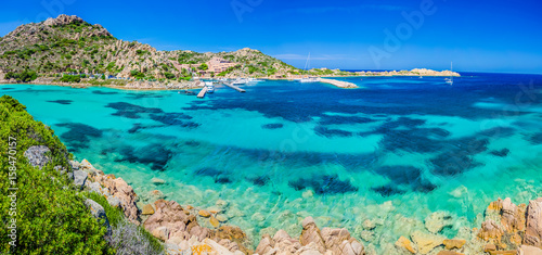 Emerald green sea water and rocks on coast of Maddalena island, Sardinia, Italy