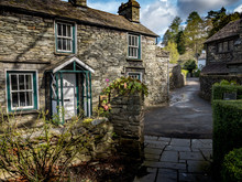 Grasmere, Cumbria, England. Traditional Slate Cottages In The English Lake District Town Of Grasmere Known As The Home Of Poet William Wordsworth.