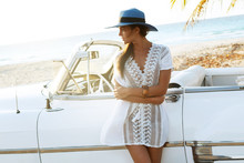 Beautiful Woman In Blue Hat And White Retro Cabriolet
