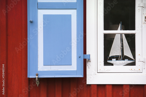 Keuken foto achterwand Schip Window with shutters and sailing boat