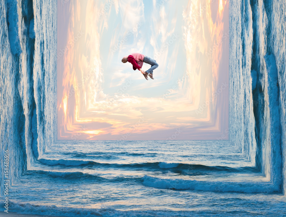 Fototapety, obrazy: Photo manipulation of a tall man letting go of all his worries as he floats weightlessly above the clouds and waves..