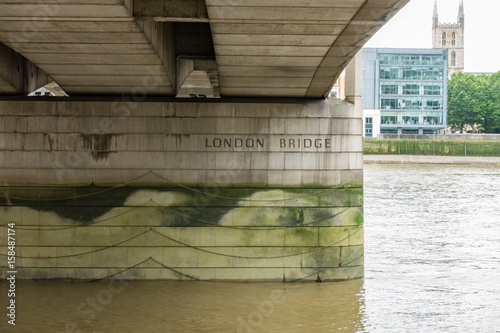 Fotografie, Obraz  View under the historical London Bridge on the River Thames in London