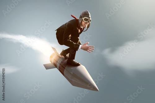 Fotografie, Obraz  Mann auf Rakete