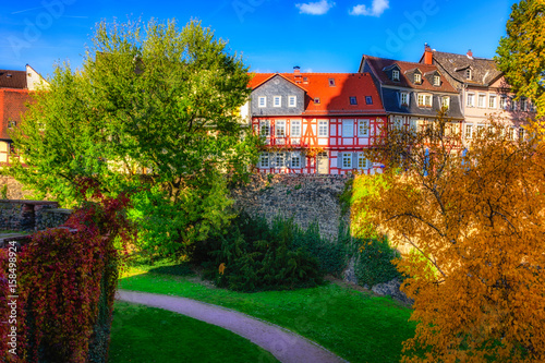 Color image of the idyllic Frankfurt-Höchst, Germany, Europe, old historical town with old houses and the castle moat on a sunny fall day with blue sky and colorful autumnal trees