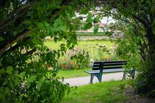 A Hidden Bench In A Park Aroun...