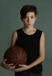 teenager boy with basketball ball close up portrai