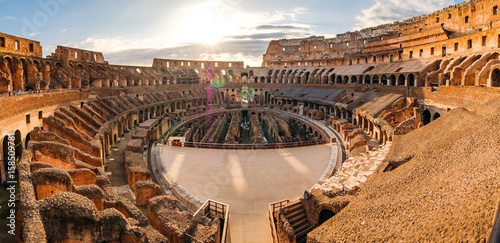 Panoramic view of Roman colosseum interior at sunset
