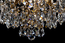 Large Crystal Chandelier Close-up In Baroque Style Isolated On Black Background.