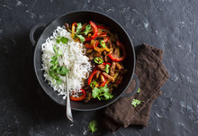 Spicy Beef With Vegetables And Rice In A Cast Iron Skillet On A Dark Background, Top View. Asian Style Food