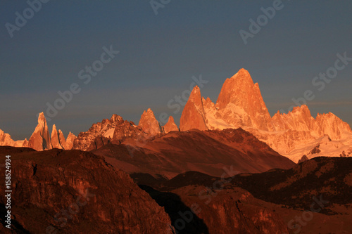 Recess Fitting Orange Glow Fitz Roy and Cerro Torre mountainline at sunrise, Los Glaciares National Park, El Challten, Patagonia, Argentina