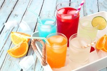 Tray Of Cool Colorful Summer Drinks Against A Rustic Wood Background