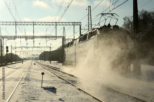 Train goes by rail in winter Wallpaper Mural