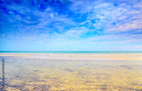 Long shallows and sand ripples on beach Canvas Print