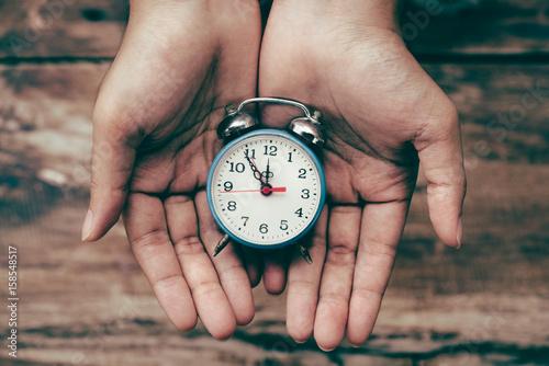Fototapeta  alarm clock in hands