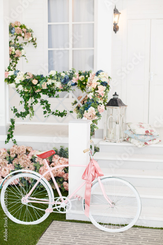 Aluminium Prints Bicycle White Bicycle near beautiful Flowers on vintage background in spring season