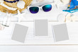 Summer Beach accessories (White sunglasses,starfish,straw hat,shell) and photo paper frame on white plaster wood table top view,Summer vacation concept,Leave space for adding your photo