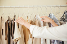 Close Up Of Clothes Hanging On Rack
