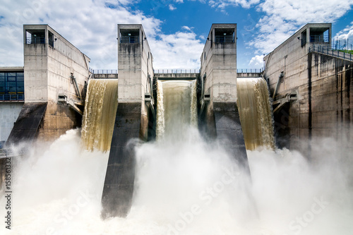Fotografering Draining water from the hydroelectric dam.