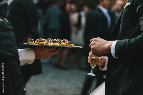 Vászonkép Apéritif de mariage, canapé petits four et amuse bouche toast foie gras tapenade