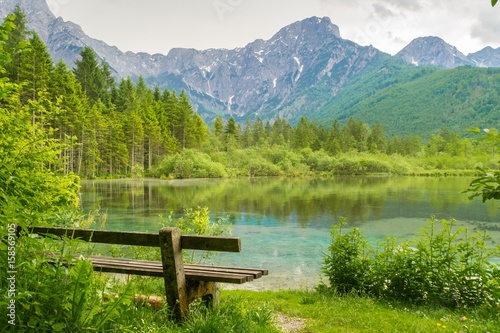 Bench near Alps mountains and lake in Almsee in Austria. Wallpaper Mural
