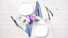 Romantic Table Serving With Purple Candle And Flowers For Two Persons, Top View