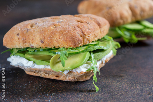 Staande foto Snack Green sandwich with soft cheese, avocado and fresh cucumber