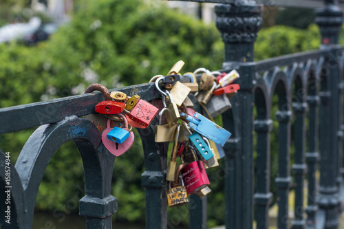 Many love locks are on the modern bridge in Amsterdam (the Netherlands, Europe) Canvas Print
